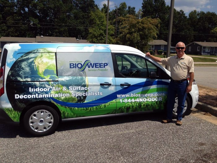 Roy Ponder, Biosweep owner, standing next to company vehicle
