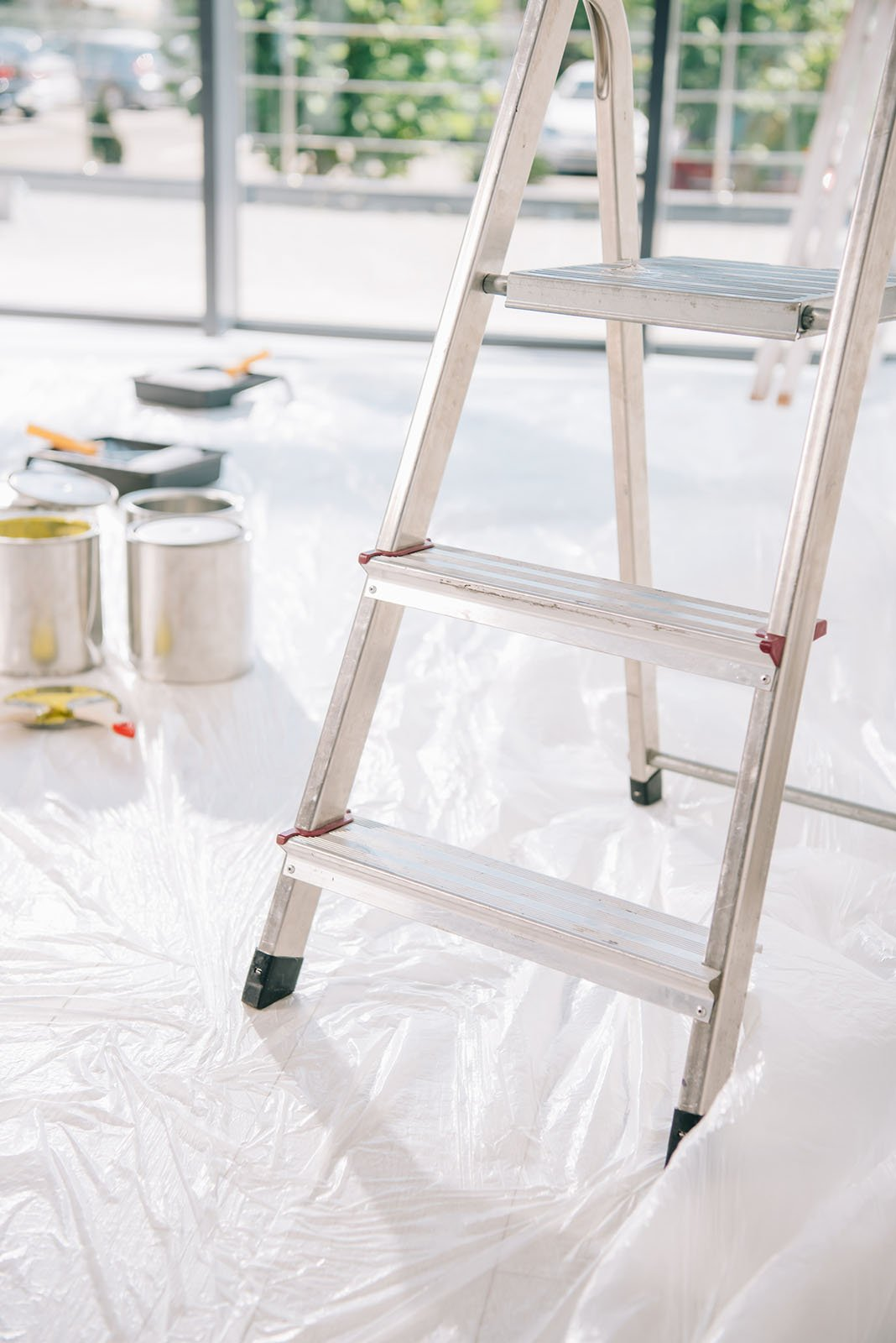 close-up of ladder and paint cans