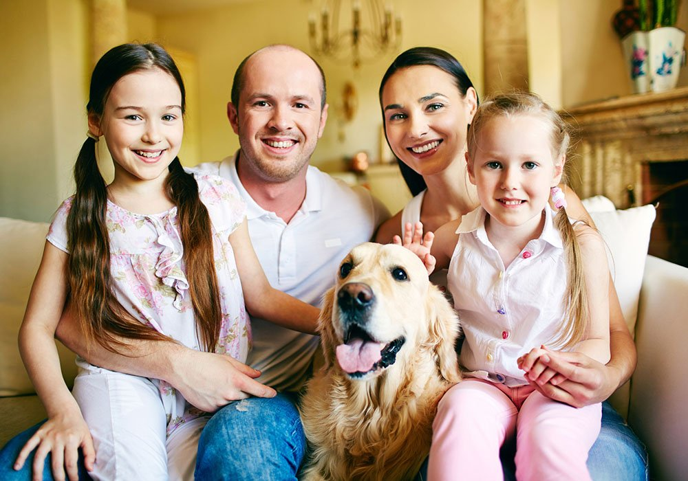 happy family of four with dog
